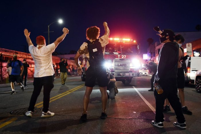 'WE'RE SICK OF IT': ANGER OVER POLICE KILLINGS SHATTERSUS